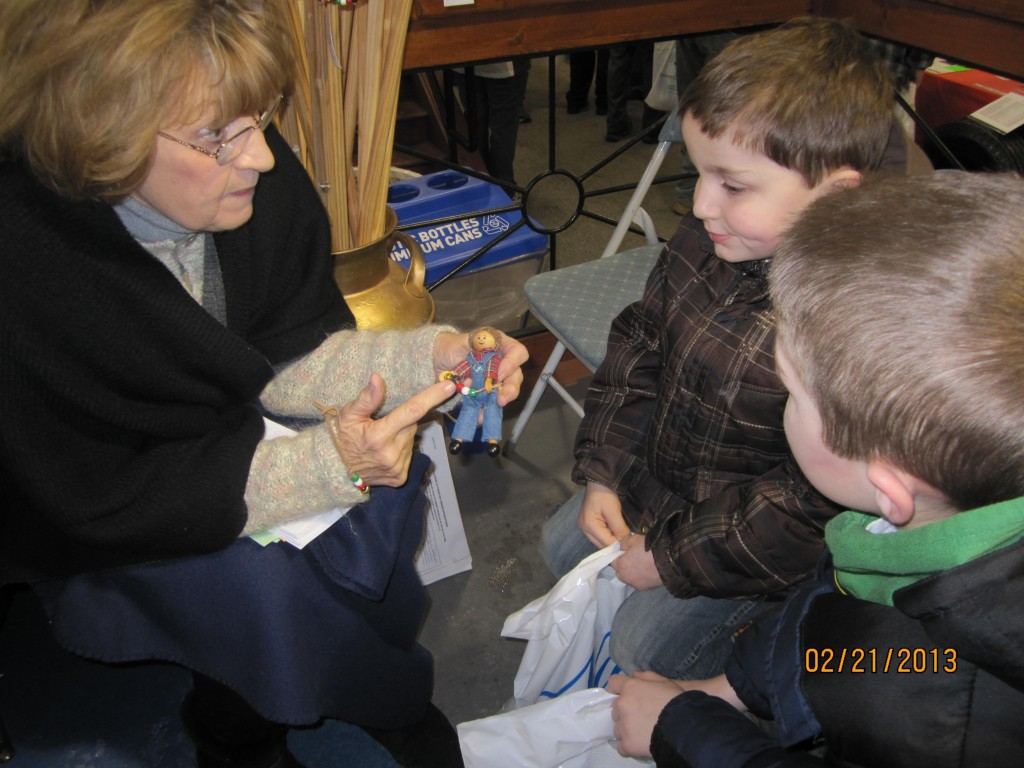 Mrs. Kathy Brown sharing the bead story using Farmer Andy at the NY Farm Show in Syracuse, NY.
